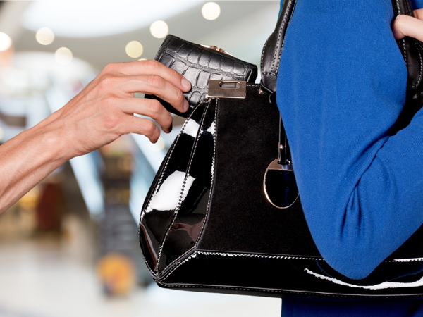 Woman Caught On Video Stealing Wallet...